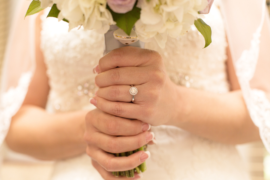 Close-up of bride's hands on her bouquet before the ceremony at Deerfield