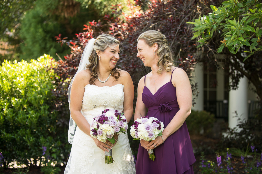 Bride laughs with her sister at Deerfield wedding