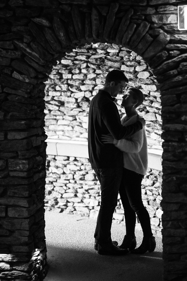 Silhouette of couple standing in brick archway