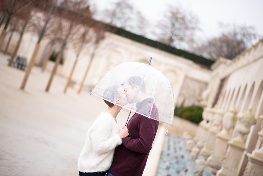 kissing under clear umbrella