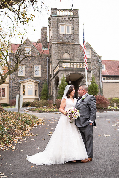 Full length shot of bride and groom in front of the University and Whist Club