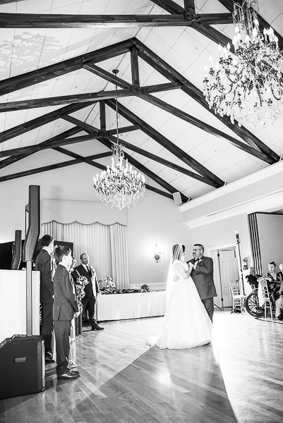 Full length black and white shot of the first dance