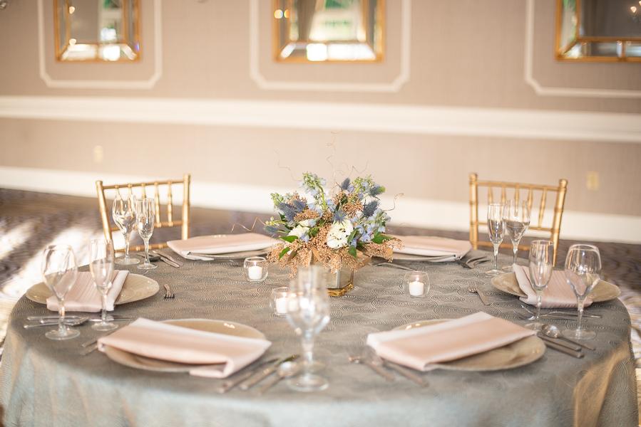 Blue and gold themed table setup for Hilton Christiana Wedding