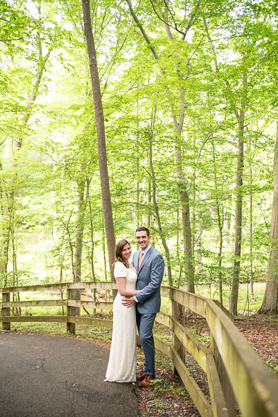 Bride and groom pose in Delaware forest