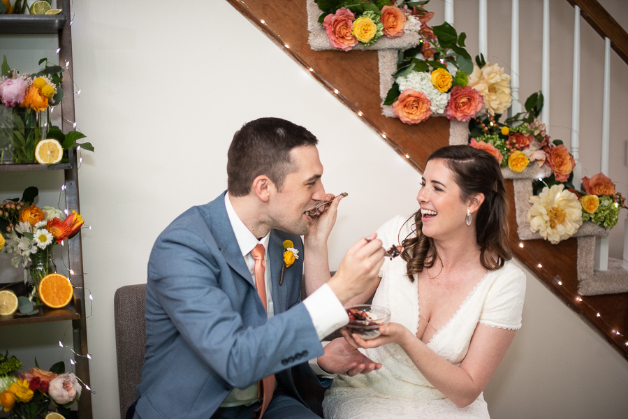Bride and groom feed each other