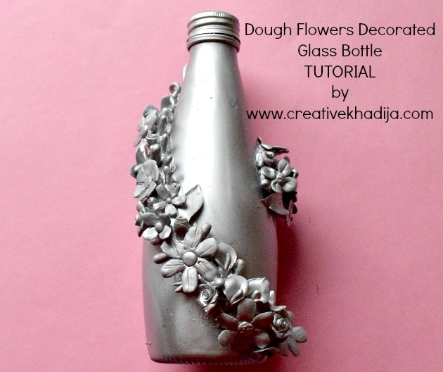 https://i0.wp.com/creativekhadija.com/wp-content/uploads/2017/02/how-to-recycle-reuse-glass-bottle-with-dough-flowers.jpg?resize=630%2C528