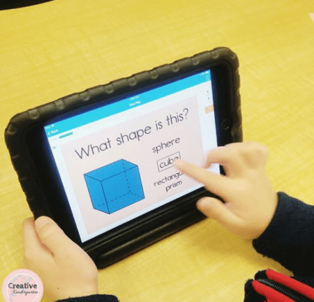 using boom cards in kindergarten to work on 3D shapes. Great way to integrate technology into your math centers.