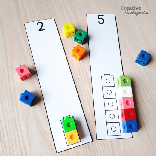 Use math manipulatives like snap cubes to practice counting, 1:1 correspondence, and number formations.