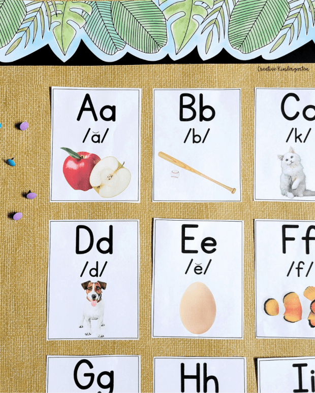 The background is a bulletin board with letter posters. The posters for A, B, C, D, E,F, G, H and I are visible.