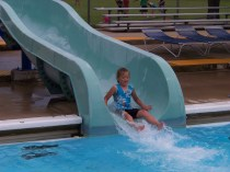 Kristi going down the water slide.