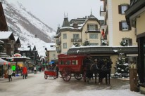 Traditional passenger pickup and delivery by horsedrawn carriage at the Mont Cervin Palace Hotel.