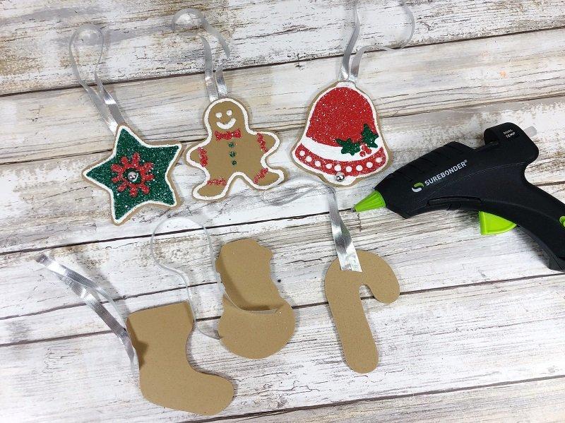 Attach ribbon hangers to Craft Foam Cookies #creativelybeth #dollartreecrafts #christmascookies #kidscrafts