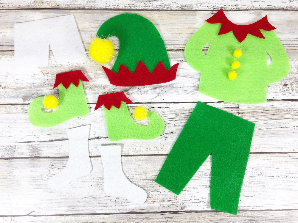Embellish Elf Clothes with Pom Poms #creativelybeth #createwithkunin #christmascrafts #feltgarland