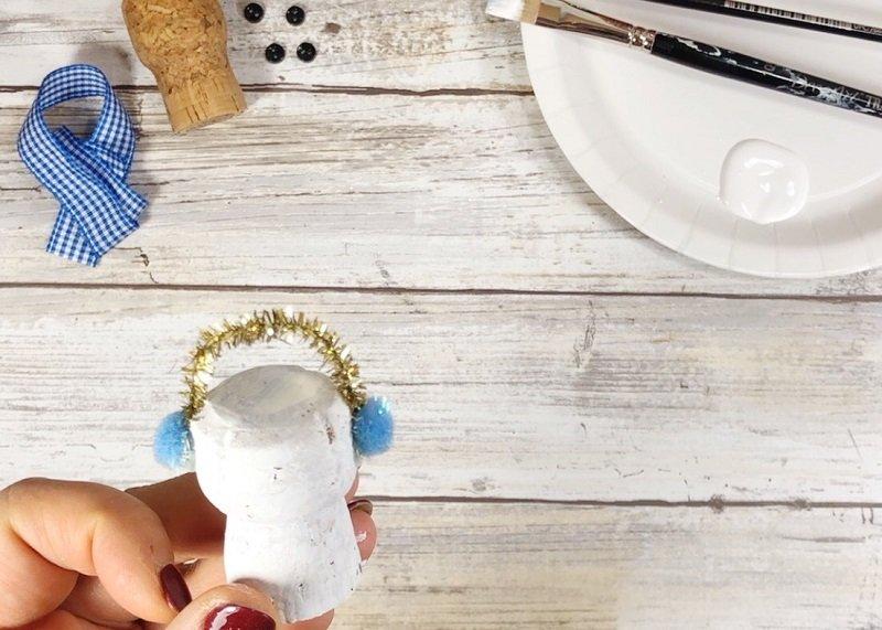 Add Earmuffs to the Cork Snowman - Creatively Beth #creativelybeth #corkcrafts #snowmencrafts #recycled #dollartreecrafts