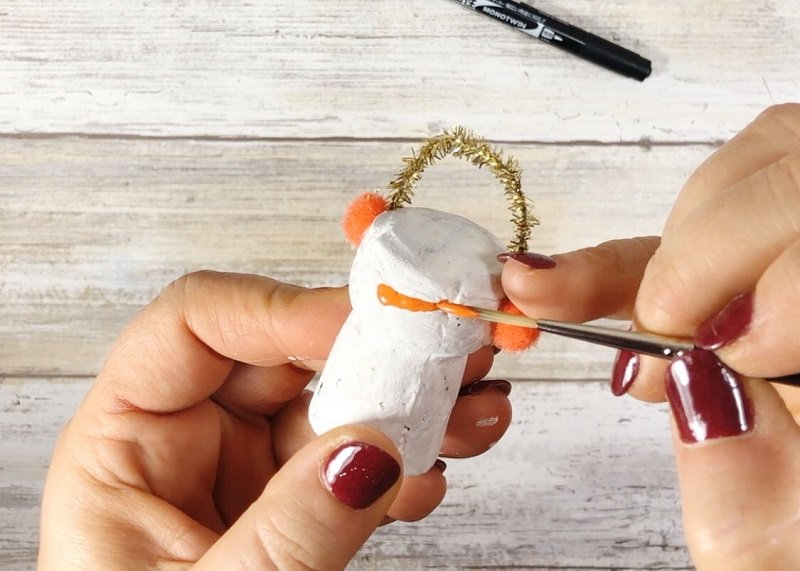 Paint a Carrot Nose on the Cork Snowman - Creatively Beth #creativelybeth #corkcrafts #snowmencrafts #recycled #dollartreecrafts