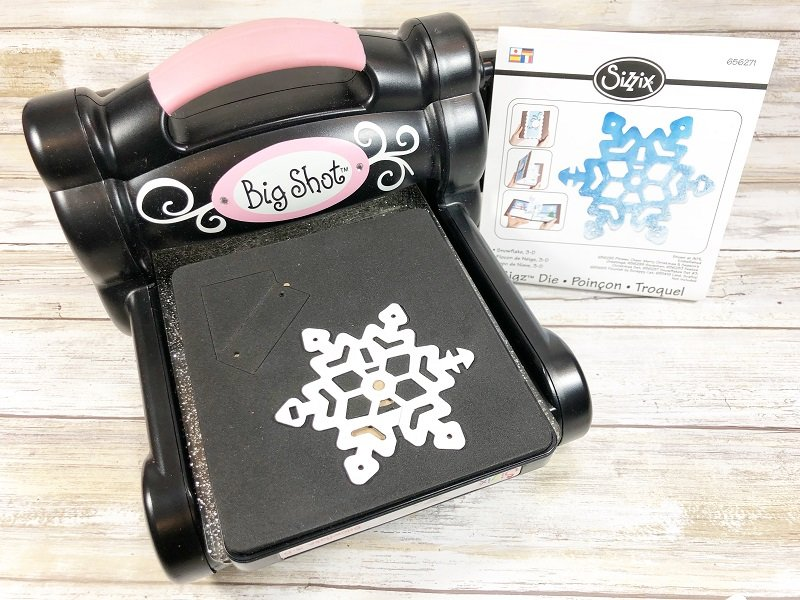 Die cut a snowflake with Sizzix Creatively Beth #creativelybeth #fairfieldworld #artabandonment #glittercrafts #heartcrafts #kindnesscrafts