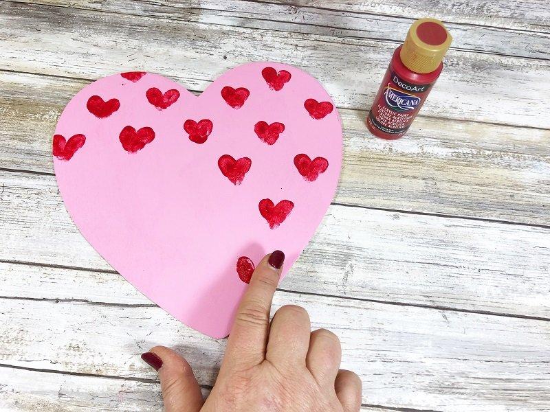 Create fingerprint hearts Hot Air Balloon Valentine Mailbox Creatively Beth #creativelybeth #dollartreecrafts #kidscrafts #valentinesdaycrafts