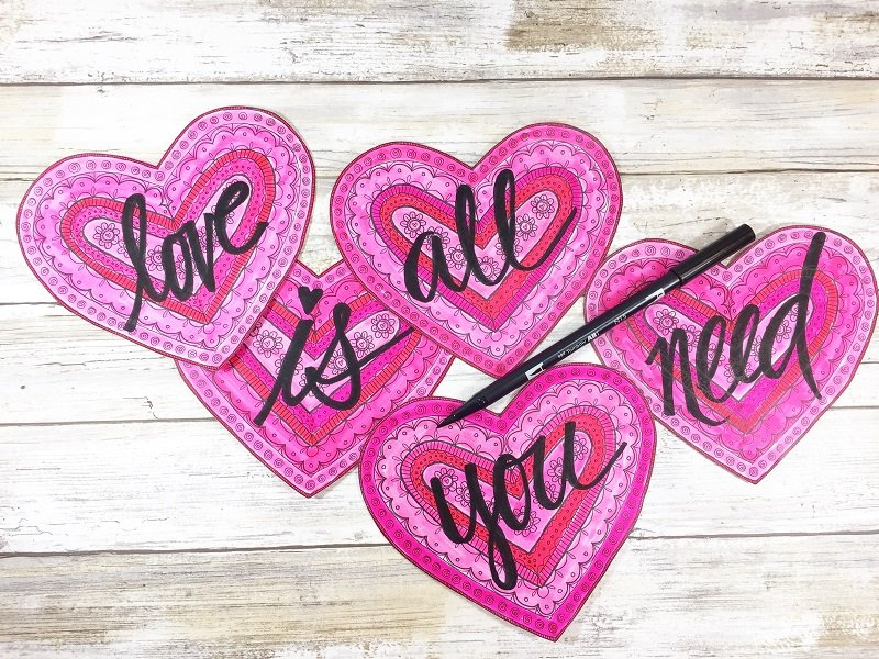 Hand letter a quote on colored hearts Creatively Beth #free #printable #handlettered #tombowdualbrushpens #heart #drawing