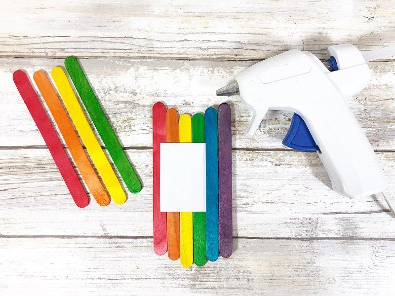 Line up craft sticks in a chevron pattern and glue together Creatively Beth #creativelybeth #rainbow #craftweek2020 #craftsticks #kidscraft