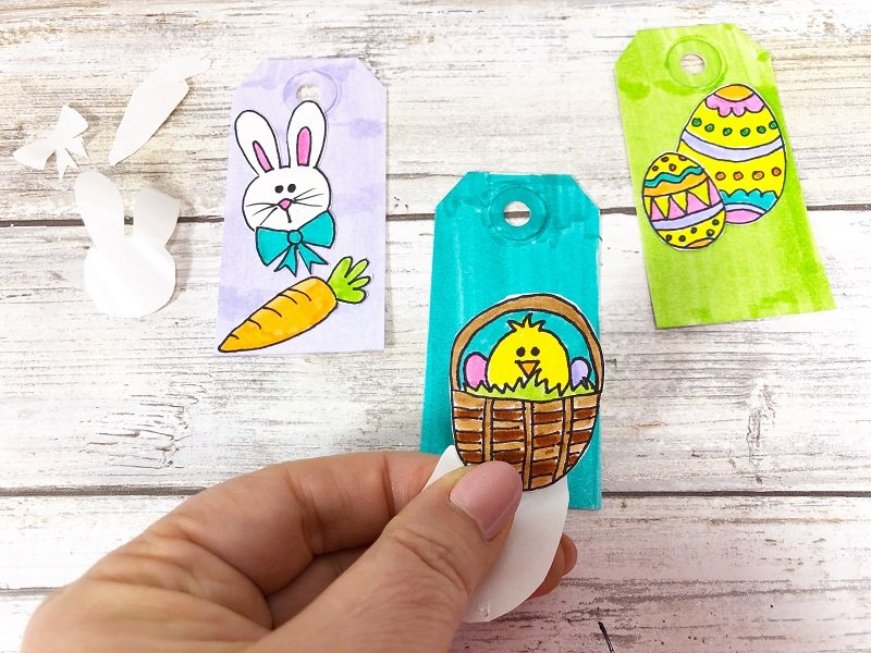 Attach stickers to tags for Easter Xyron Creatively Beth #creativelybeth #doodles #freedownload #printable #eastercrafts #xyron