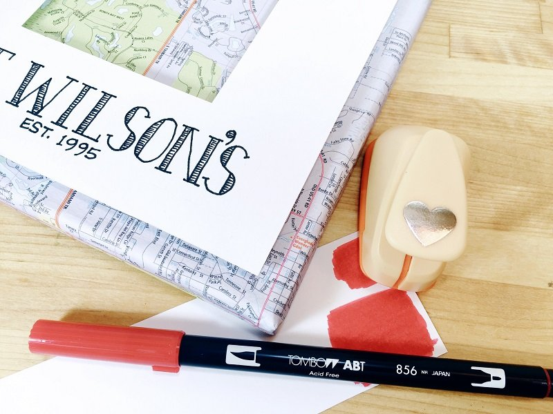 Color a scrap of paper red, punch out a heart and attach to map canvas where you live Creatively Beth #creativelybeth #upcycled #recycled #crafts #maps