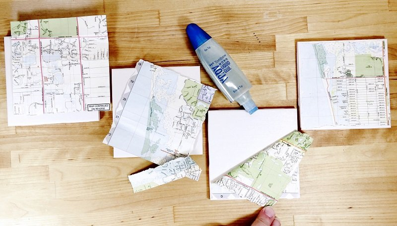 Cut sections of map and decoupage to white ceramic tiles with MONO Aqua Liquid Glue Creatively Beth #creativelybeth #upcycled #recycled #crafts #maps