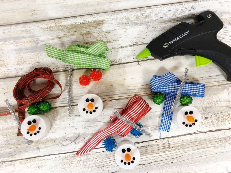 Ribbon for scarves, pom poms and chenille stems for earmuffs Creatively Beth #creativelybeth #dollartreecrafts #christmas #ornaments