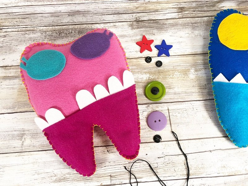 Attach small black buttons to larger colored buttons with black embroidery floss Creatively Beth #creativelybeth #toothfairy #fairfieldworld #80daysofpolyfil #polyfil #felt #monster #craft