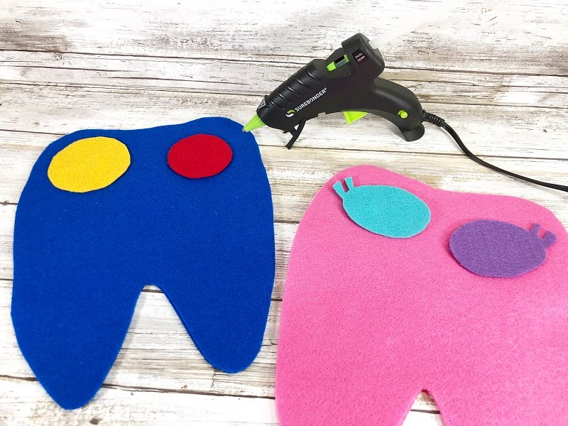 Attach eye cut outs to top front of monster felt pieces with hot glue Creatively Beth #creativelybeth #toothfairy #fairfieldworld #80daysofpolyfil #polyfil #felt #monster #craft