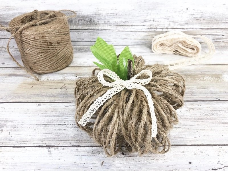 Add a bow made from ribbon or lace Creatively Beth #creativelybeth #dollartreecrafts #twinepumpkins #fallhomedecor