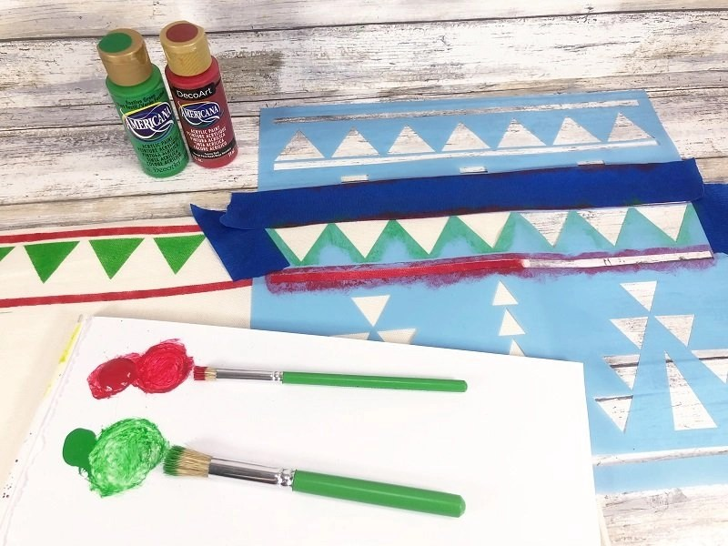 Stencil a triangle and straight line pattern along the top and bottom edges of the pillow cover Creatively Beth #creativelybeth #fairfieldworls #uglychristmassweater #pillowparty2020 #stenciled #decoart
