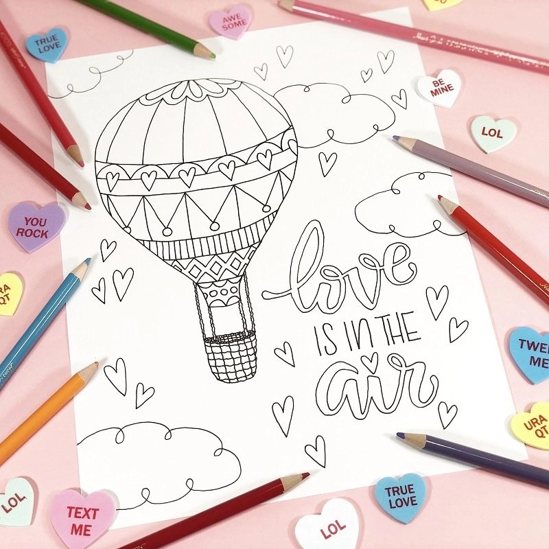 Love is in the Air Coloring Page by Creatively Beth #creativelybeth #valentinesday #freeprintable #coloringpage #handdrawn #handlettered