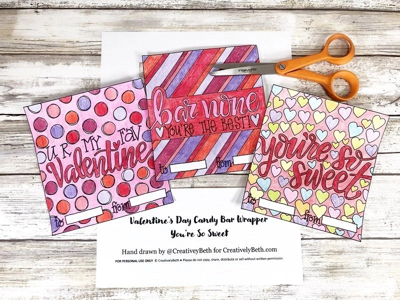 Once colored, cut Candy Bar Wrappers out with scissors Print and color Free Candy Bar Wrappers for Valentine's Day Creatively Beth #creativelybeth #freeprintable #candybarwrappers #valentinesday