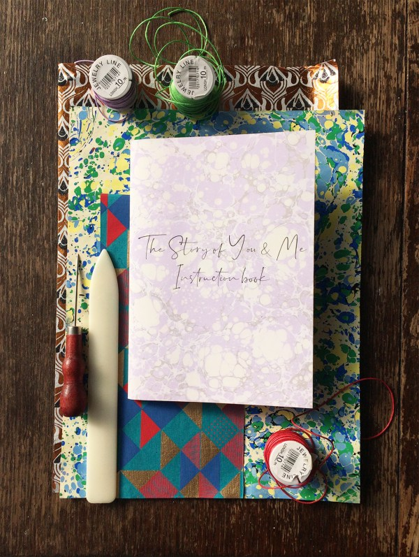 book making materials with the story of you and me pages