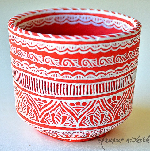 Cup made of Clay hand painted in style inspired from Mithila / Madhubani Painting