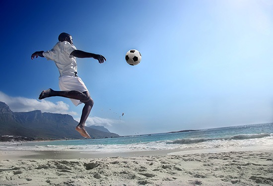 bigstock-soccer-player-on-the-beach-of--12150368