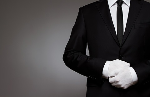 At Your service. Well dressed man waiting for orders with copy space.