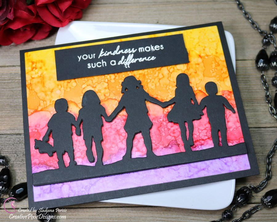 Spellbinders Away We Go Etched Dies combined with a sunset ombre alcohol ink background from Ranger Alcohol inks.