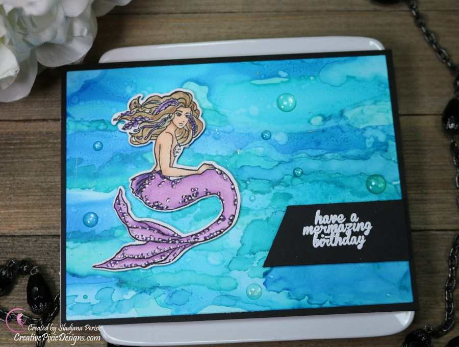 Hero Arts Stamp and Cut Mermaid combined with an underwater alcohol ink background from Ranger Alcohol inks.