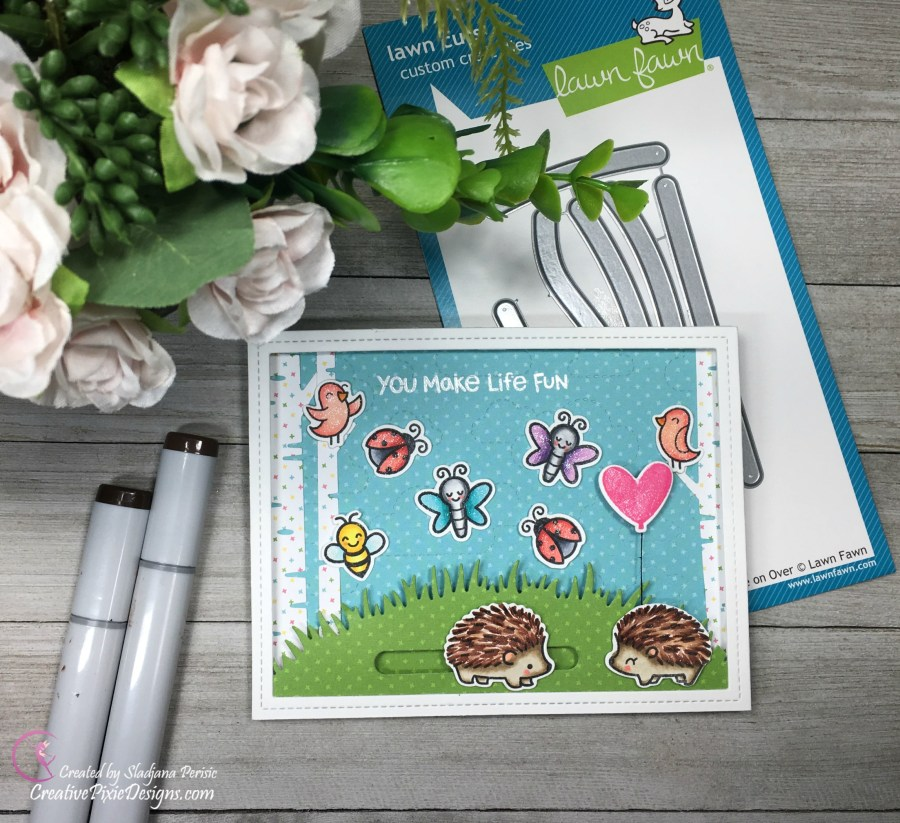 A spring inspired card created with Lawn Fawn Hedgehugs Stamp and Slide on Over Dies, colored with Copic markers and set against a mini forest scene.