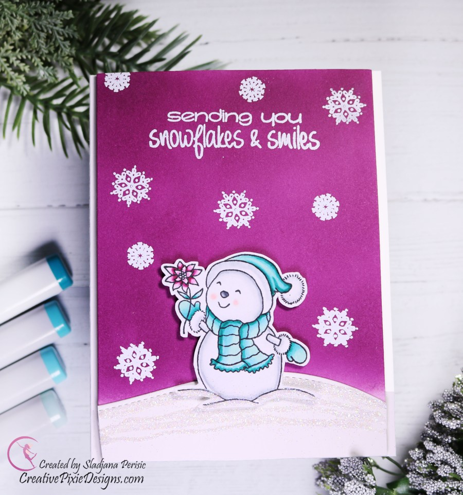 Your Next Stamp Frosty Friends stamped image colored with Copic Markers set against an ink blended background for a sparkly Christmas handmade card.