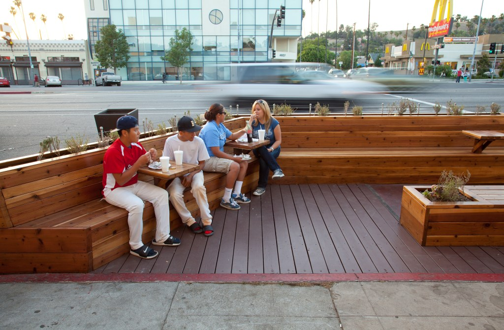 Huntington Drive parklet Flickr photo by LADOT People St https://www.flickr.com/photos/ladotpeoplest/10176053366/