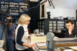 Image of Maggie Stogner filming expert for museum exhibit