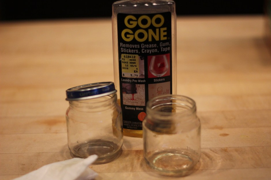 Peel the label off of the baby food jar and use Goo Gone to get the gook off.