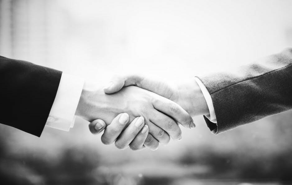shaking hands to warm-up personal communication
