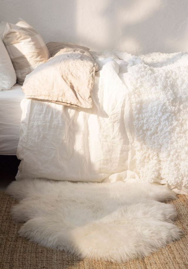 cozy white bedroom with soft plush rug
