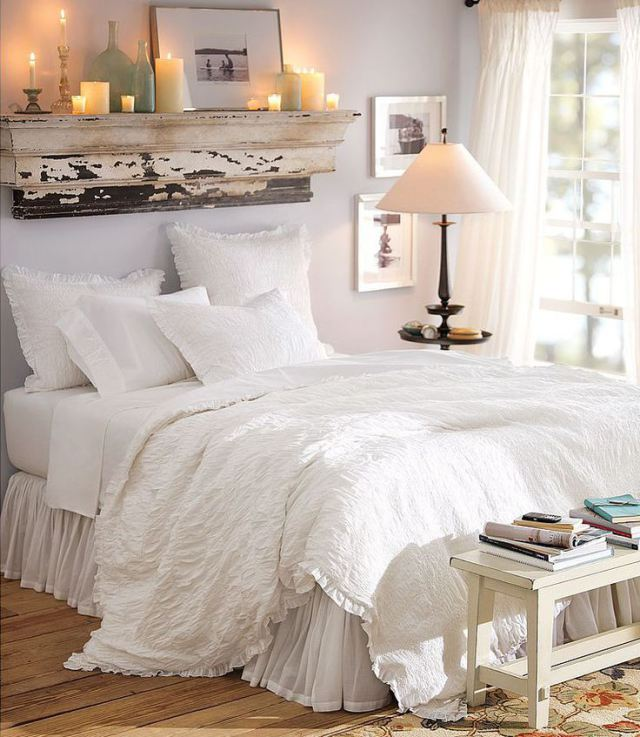 cozy bedroom with romatic lighting and white sheets