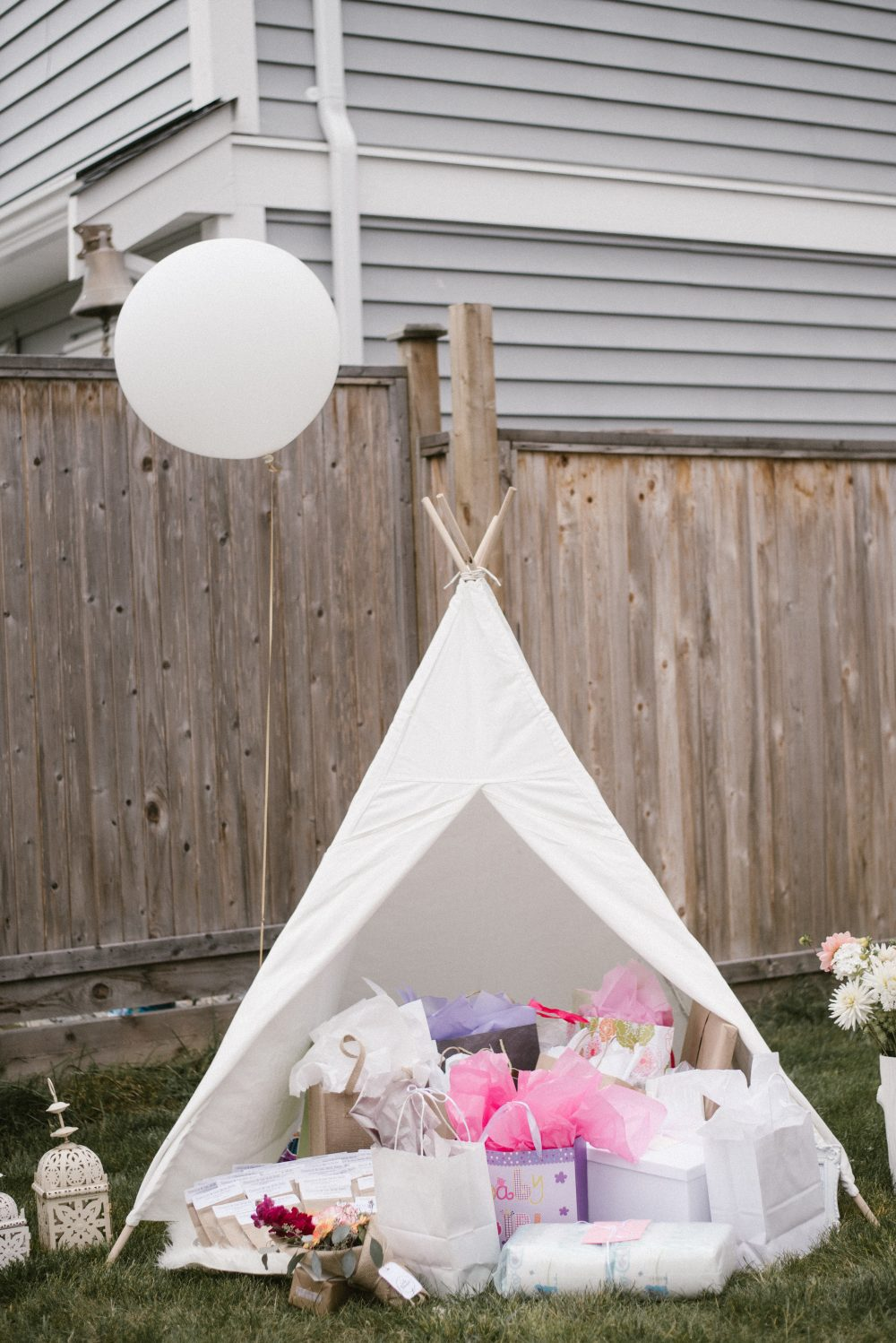 Gift Table inside white play tent and boho shower