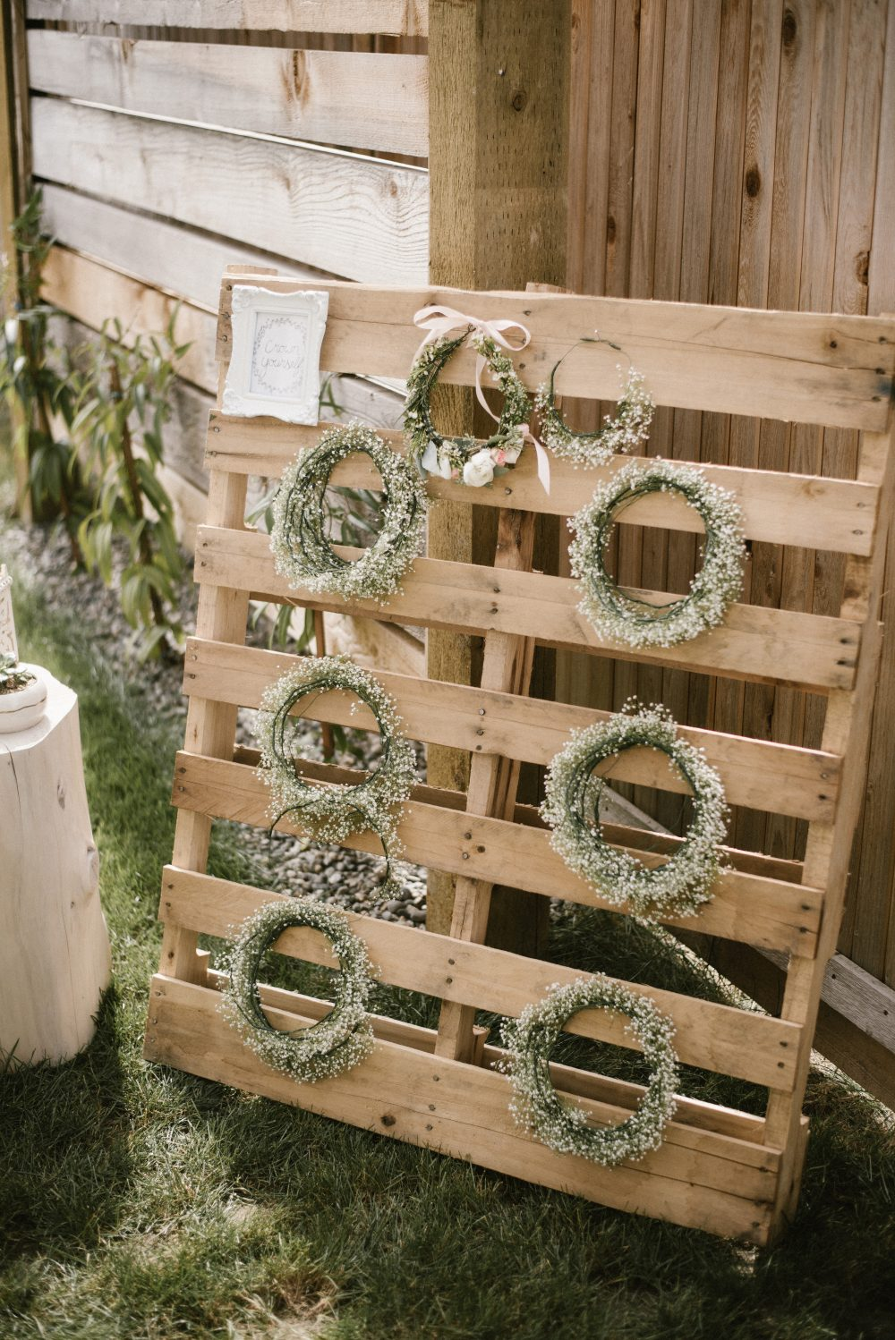 Crown station at floral and white baby shower | White Boho Baby Shower