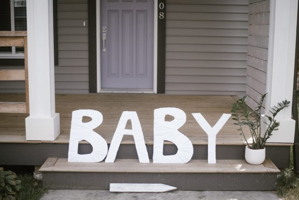 DIY fabric wrapped baby sign for meet the baby shower | White Boho Baby Shower